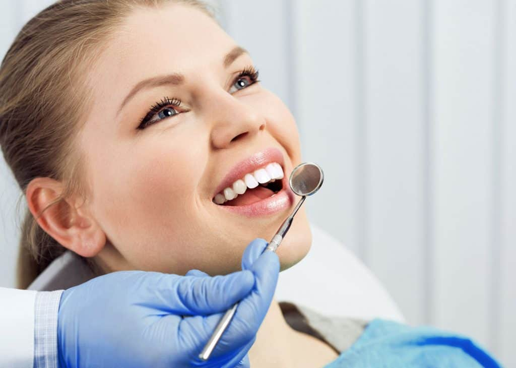 Woman Smiling After Dental Implants